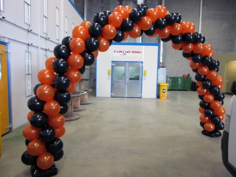 Back drop balloon arch for factory launch. www.corporaterewards.com.au