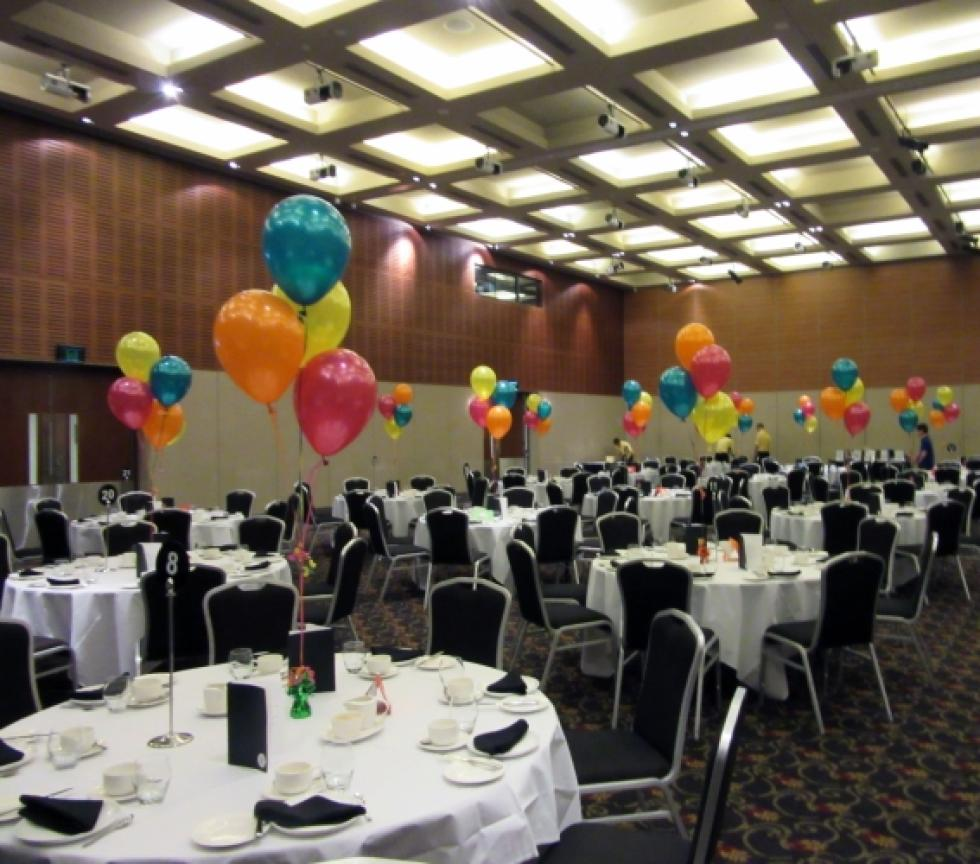 Helium Latex Balloon Table Arrangements | metallic teal, orange, yellow & magenta balloons Fremantle Esplanade Hotel | CorporateRewards.com.au