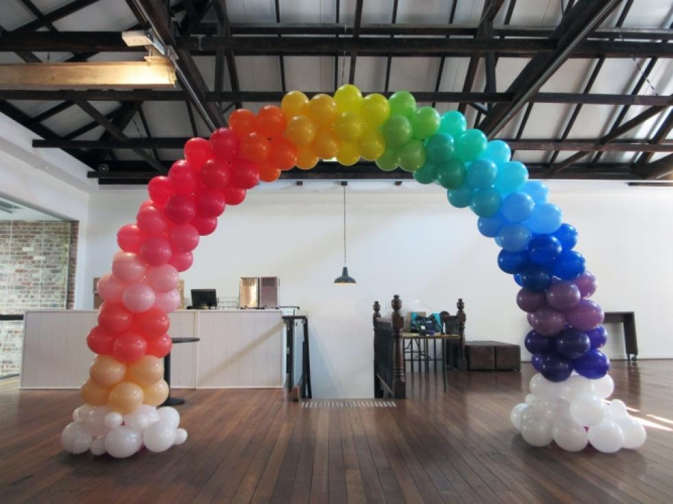 Giant Rainbow Balloon Arch with Clouds | The Flour Factory www.corporaterewards.com.au