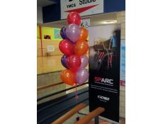 Balloon Arrangements with purple, lilac, orange & red metallic balloons | YMCA Morley www.corporaterewards.com.au